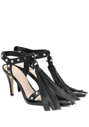 Fringed and studded leather sandals