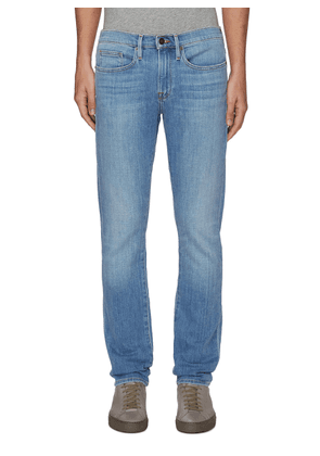 L'Homme' faded knee slim jeans