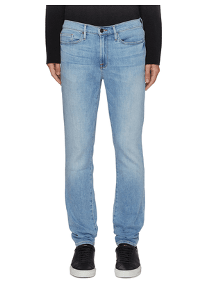 L'Homme Core' light wash skinny jeans