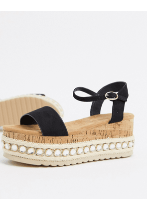 Truffle Collection studded flatform sandals in black