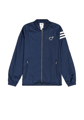 adidas x HUMAN MADE Windbreaker in Collegiate Navy - Blue. Size L (also in M).