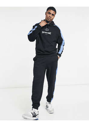 ASOS DESIGN oversized tracksuit with side panels and chest print in black & blue