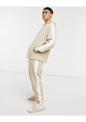 ASOS DESIGN oversized tracksuit in beige with white side stripe