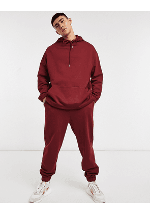 ASOS DESIGN organic tracksuit with oversized hoodie & oversized joggers in burgundy-Red