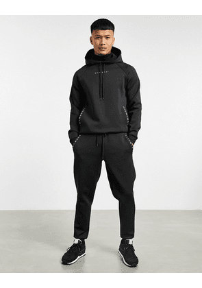 ASOS DESIGN co-ord tapered joggers in black scuba with Roman numerals printed zips