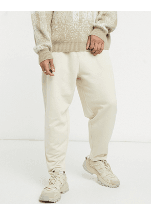 ASOS DESIGN oversized tapered joggers in beige