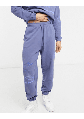 ASOS DESIGN co-ord oversized joggers with graffiti prints-Blue