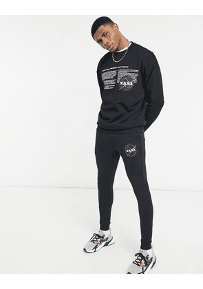 ASOS DESIGN Co-ord super skinny jogger with Nasa print in black