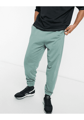 ASOS DESIGN co-ord oversized joggers in washed green-Blue