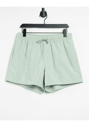 ASOS DESIGN swim shorts in pastel green with pintuck in short length