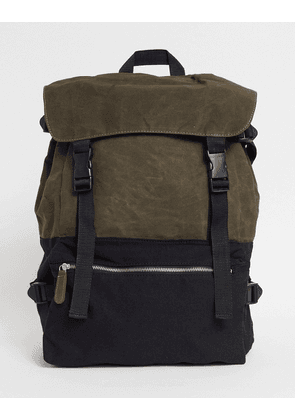 ASOS DESIGN oversized backpack in black and khaki canvas with multi-compartments-Green
