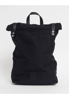 ASOS DESIGN rolltop backpack in black canvas with leather trims