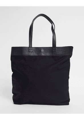 ASOS DESIGN oversized tote bag in black canvas and leather