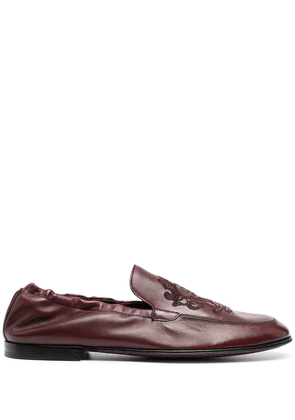 Dolce & Gabbana debossed-motif polished-finish loafers - Red