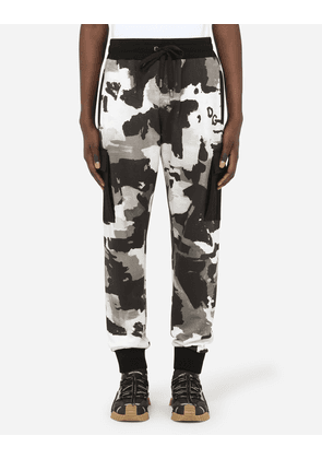 Dolce & Gabbana Trousers and Shorts - CAMOUFLAGE JOGGING PANTS WITH PATCH EMBELLISHMENT MULTICOLOR male 54