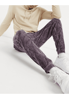 ASOS DESIGN co-ord tapered joggers in purple crinkle wash