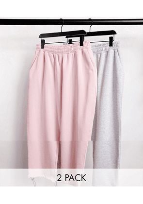 ASOS DESIGN super oversized joggers 2 pack in pink/white marl with toggle hem-Multi