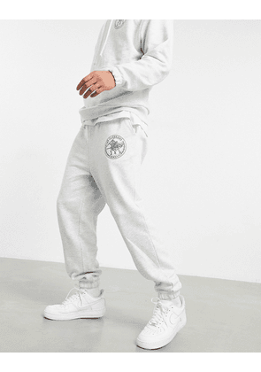 ASOS DESIGN co-ord oversized joggers with Roman numerals logo print-White