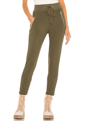 The Range Alloy Rib Zip Pant in Brown. Size M, S, XS.
