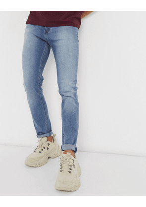 ASOS DESIGN skinny jeans in classic mid wash blue