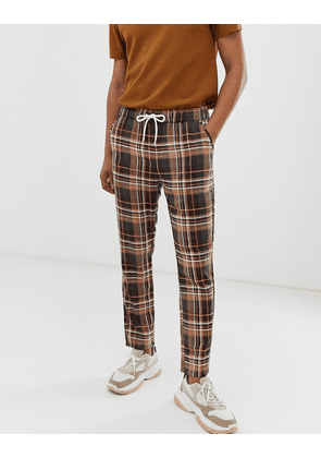 ASOS DESIGN slim trousers with elastic waist in brown check