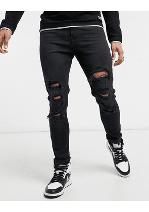 Bershka super skinny fit jeans in black with rips