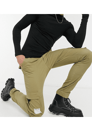 ASOS Unrvlled Supply Tall tapered cargo trousers in stone-Beige