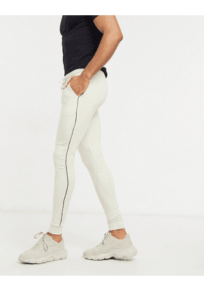 ASOS DESIGN organic super skinny joggers in light beige with piping-Grey