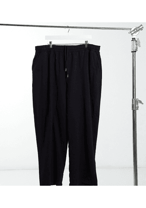 ASOS DESIGN Plus organic super oversized joggers in black with toggle hem