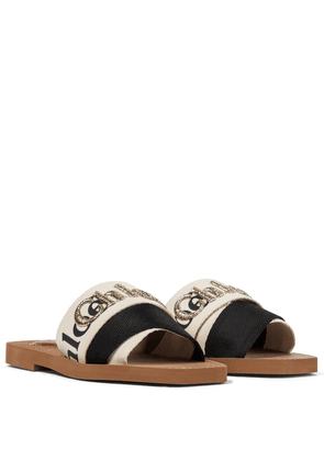 Woody embroidered canvas slides