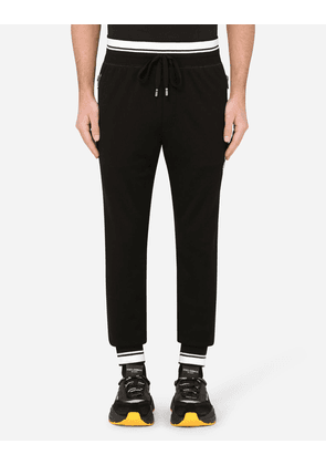 Dolce & Gabbana Collection - JERSEY JOGGING PANTS WITH CROWN AND DG PRINT BLACK male 56