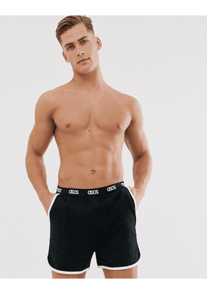 ASOS DESIGN lounge runner short in black with contrast binding and branded waistband