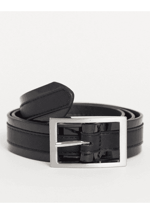 ASOS DESIGN slim belt in black faux leather with shiny detail