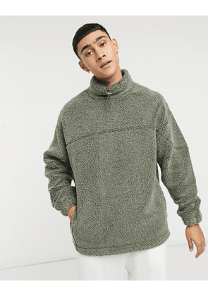 ASOS DESIGN oversized washed teddy borg funnel neck sweatshirt with seam details-Green