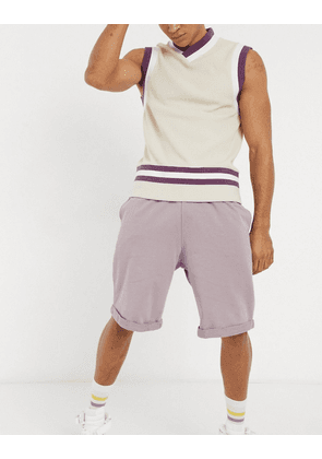 ASOS DESIGN oversized jersey shorts in washed purple with rolled hem