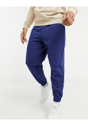ASOS DESIGN oversized joggers in blue-Navy