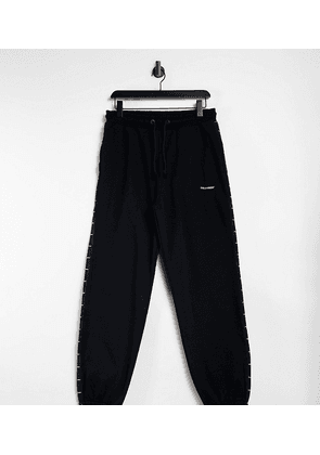 COLLUSION Unisex oversized joggers with logo side tape in black co-ord