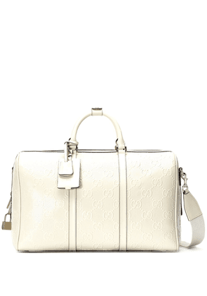 Gucci logo-embellished holdall bag - White