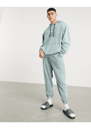 ASOS DESIGN oversized tracksuit with hoodie in acid washed green