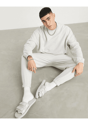 ASOS DESIGN oversized tracksuit with sweatshirt and joggers in reverse loopback in light grey