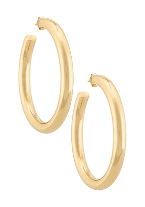 The M Jewelers NY The Thick Hoop Earrings in Metallic Gold.