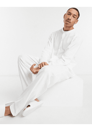 ASOS DESIGN lounge onesie in ribbed fabric-White