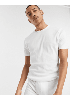 ASOS DESIGN ribbed t-shirt and trunk pyjama set in white
