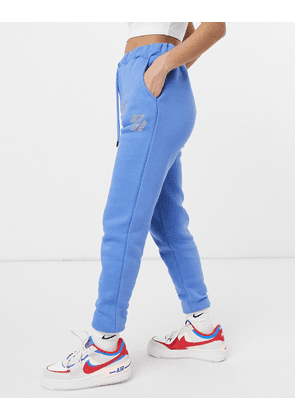 Criminal Damage oversized joggers with rhinestone embellished logo in blue