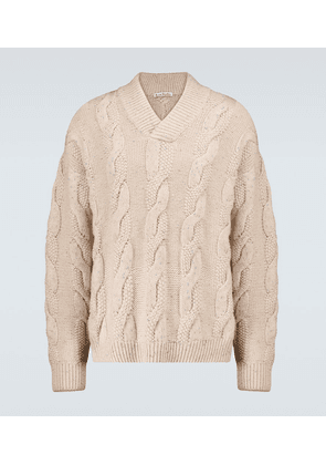 Karakia V-neck cable-knitted sweater