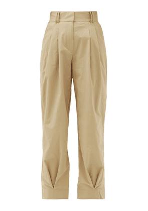Aje - Tapered Crinkled-crepe Trousers - Womens - Beige
