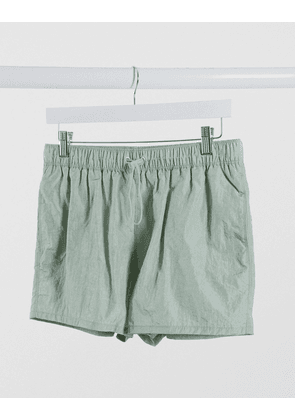 ASOS DESIGN swim shorts in crinkle texture with toggle fastening in short length-Green