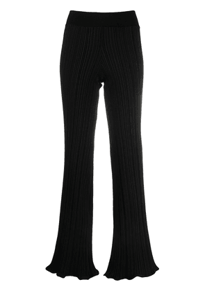 Acne Studios stretch-fit ribbed trousers - Black