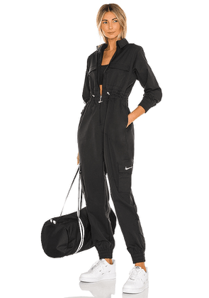 Nike NSW Swoosh Utility Jumpsuit in Black. Size M, S, XL.