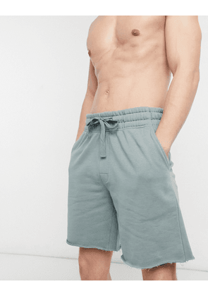 ASOS DESIGN lounge relaxed shorts with raw hem in dark blue-Grey